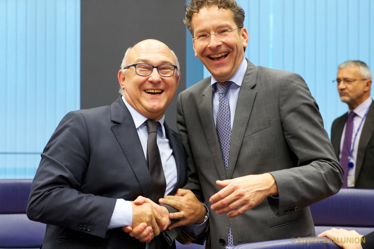 Michel Sapin (left) and Jeroen Dijsselbloem at the Eurogroup, 13 Oct. 2014 [Photo: Council of the European Union]
